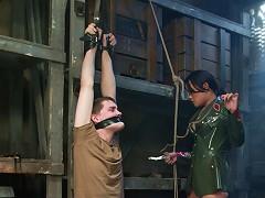 Mistress Annie Cruz in military bondage scene