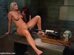 Blond mom machine fucks co-ed girl with a powerful pistol machine, both ride sybians and cum. MILF