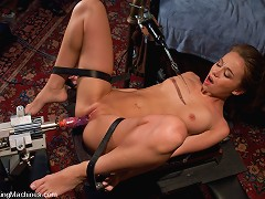 Amateur co-ed girl pulled by a machine back and forth onto a moving robot cock. She gets sweaty