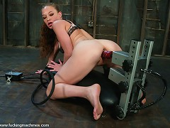 Fast, hard machine pounding satisfies this sexy red head.