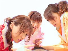 A man comes in and lays down while the three girls experiment on him