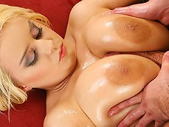 First Pamela teases you guys with her huge hooters before we bring in a lucky dude to cover her in oil. N