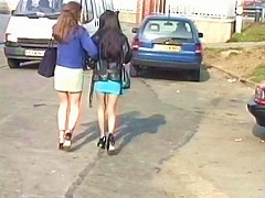 Two girls piss on a public street