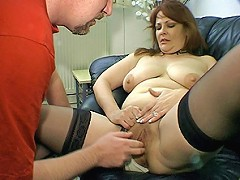 Watch a redhead MILF and her big naturals