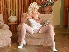Watch as the aptly-named Tall Goddess puts nylons on her long legs, then takes them off, along w