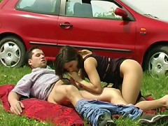 A picnic can never really be innocent can it? This couple pulls over on a grassy field and gets down to business almos