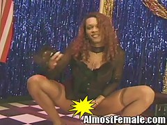 Heres a hot tranny stripper that cant get enough action. Shes an ebony babe with long curly hair and a curvy b
