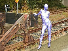 Hot Trinity exposes her lustful body in silver spandex suit in a bus station!