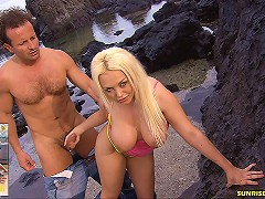 Hot blonde Kathy Anderson with big boobs gets fucked on the tropical island.