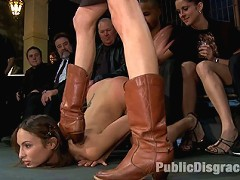 Amber Rayne gets double and triple penetrated, made to lick pussy, clean boots, and entertain a merciless crowd of Princes