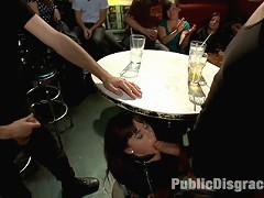 Gia DiMarco is made to squirt all over herself in a bar full of gawkers