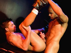 Dominic and Austin kiss deeply and their bodies meld into one blur of sweat and lights. Dominic kisses down Austins wet