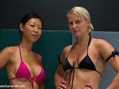Big bully blond kicks the ass of a tiny Asian girl with big boobs, then fucks her in the ass with a strap on!