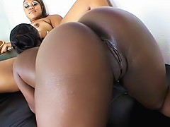 Two black chicks with dripping wet snatches get their holes slammed by pleasing fuck toy