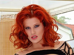 Roses is a redheaded MILF dressed in a sexy fishnet outfit. She surprises us when she squirts a bit of milk from her ti