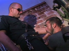 Slammed against a wall and handcuffed by Sergeant Scott Tanner, Steve Cruz is put at the mercy of hi
