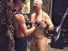 The dungeon debauchery goes on. The naked slave is freed from his wrist restraints only to be brought to the floor for m