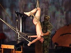 Tied and hung upside down, theres no way this slave can escape the beating shes taking