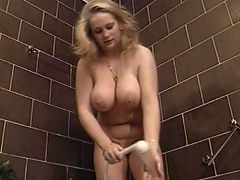 Join this megaboobed, blonde whore in the shower, as she gone naked, revealing her voluptuo