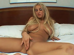 Stay focus on this gorgeous blonde hussy as she takes her clothes off and shows her nice pair of boo