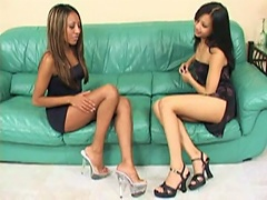 Two exotic looking Asian bitches got together and their pussies are  ready to be treated to a hard pumping cock penetrating deep