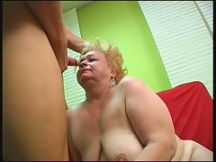 This dirty blonde grandma has good taste when it comes to her men. Look at this bitch as she gets her saggy set of breasts licked o