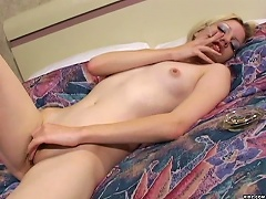 Gorgeous blonde, Heidi Rain pleasures herself by caressing her own tits and pussy while puffin her cigar. She uses