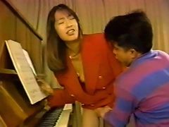 This mega cute Japanese chick is trying to learn to play the piano, but the only thing she is good in playing is with dirty m