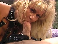 She is a sexy blonde bitch who loves wearing black leather boots and gloves while