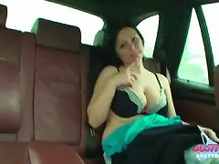 Ellen sits in the back of a car and slowly strips off to show her big massive boobs
