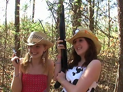 These two southern gals have fun posing for the camera out in the woods. See them holding guns and striking a pose and