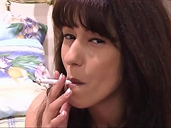 Shes like a whore smoking while teasing. This nasty bitch knows how to seduce a man as she stares and p