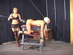Blonde gets punished as her arms and feet were bound on a horse stool. Flat on her belly, her hands and legs