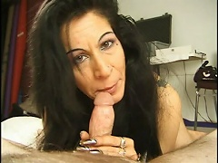 This jet black haired mama loves giving men blowjobs. She just loves it when it goes in and out of her mouth, br