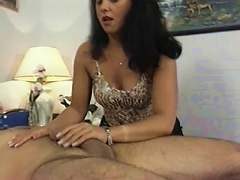 This wild, brunette mamma is one big fan of cock wanking.  She loves to see the studs whole body twitching while shes stroking h