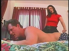 She gets so filthy hot when she straps on a man in bed, helplessly asking to be spanked. Then