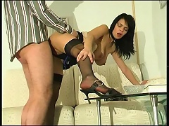 Nasty brunette makes a client hot to trot with her black nylons and heels