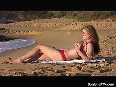 Danielle plays on the beach