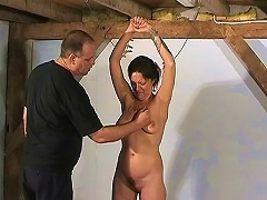 Mature slave is forced to lick his masters boots