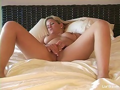 Lia 19 plays on her bed