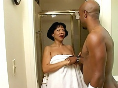 This clip begins with Latina milf Bambi coming out of the shower and then a black hunk welcomes her. They moves into the bedroom wh