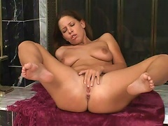 Come see this young brunette slut having a good time under the sun as she is lustfully stroking her throbbing