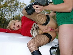 A blonde in laced stockings and boots comes to have oral and traditional sex for money