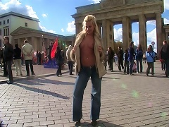 A young blonde girl strips off completely in public and later on shows her tits too in publ