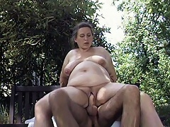A very pregnant babe is sucking off a big cock while the guy fondled with her plump tits. The guy made her take his dick