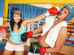 A teenage girl is having a mock boxing match with a guy. He takes off his gloves and starts touching her up, li