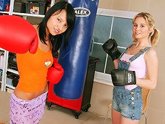 Two teenage girls are having a little boxing game. They take off their gloves and start undressing each oth