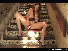 Danielle plays on the stairs