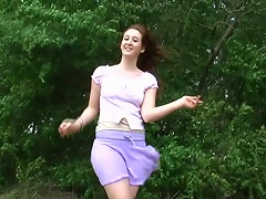 Its a lovely day to go outside and admire the breathtaking view. See this brunette chick as she walks in the green